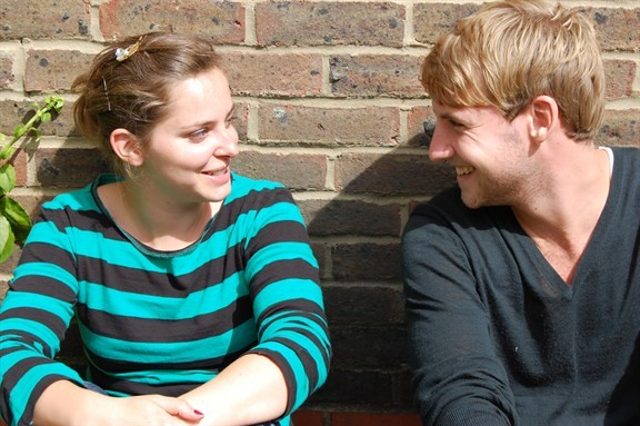 0050_young_people_talking_576x383